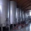 Stainless steel wine vats in a row — Stock Photo #65354989