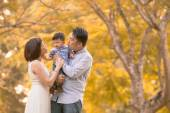 Asian young family having fun outdoors in autumn — Stock Photo