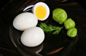 Boiled eggs with brussels sprouts — Stock Photo