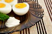 Boiled eggs with mayonnaise and dill — Stock Photo