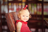 Happy little girl waiting in cafe — Foto Stock