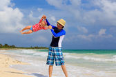 Father and little daughter having fun on summer beach — Stock Photo