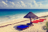Beach chairs in luxury resort on carribean coast — Stock Photo