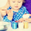 Mother and little daughter painting easter eggs — Stock Photo #68572479