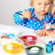Mother and little daughter painting easter eggs — Stock Photo #68572505