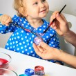 Mother and little daughter painting easter eggs — Stock Photo #68572511