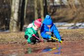 Kids playing with water in spring — Stock Photo