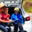 Family looking at map while travel by car — Stock Photo #72825099