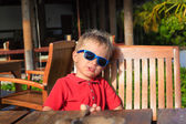 Little boy waiting in wooden cafe — Stock Photo