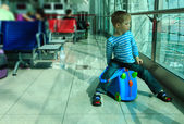 Little boy waiting in the airport — Stock Photo