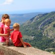 Mother with kids looking at scenic view in mountains — Stock Photo #82481040