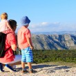 Father with kids on mountains vacation — Stock Photo #82599064
