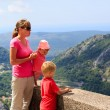 Mother with kids looking at scenic view in mountains — Stock Photo #83139470
