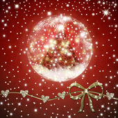 Christmas tree  inside shiny ball on red background — Stok fotoğraf