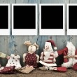 Christmas four empty photo frames Santa doll — Stock Photo #60529809