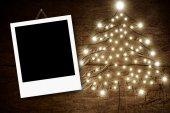 Photo frame Christmas tree wooden background — Stockfoto