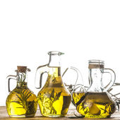 Herbs and garlic olive oil — Stock Photo
