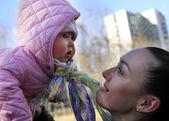 Happy mom and child girl — Stock Photo