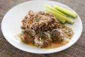 Buckwheat with small meat balls — Stock Photo
