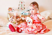 Little girl with a gifts — Stock Photo