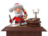 Санта-Клаус с телефона и ручки — Стоковое фото