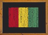 Guinea flag on a blackboard — Stock Photo