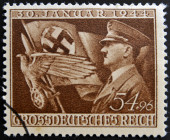 GERMANY - CIRCA 1944: A postage stamp printed in the Germany shows Adolf Hitler and symbols of Third Reich, circa 1944 — Stock Photo