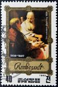 "DPR KOREA - CIRCA 1983: A stamp printed in North Korea  shows Rembrandt painting ""two scholars disputing"", circa1983 — ストック写真"