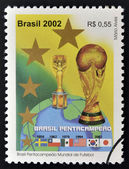 BRAZIL - CIRCA 2002: a stamp printed in Brazil showing an image of the World Cup trophy and the years that Brazil won the World Cup, circa 2002. — Stock Photo