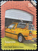 AUSTRALIA - CIRCA 2009 : a stamp printed in Australia shows australian inventions speedos  Ute Roll a door, circa 2009 — Stock Photo