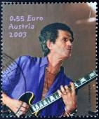 AUSTRIA - CIRCA 2003: A stamp printed in Austria shows image of famous English musician, composer, singer and songwriter Keith Richards, circa 2003. — Stock Photo