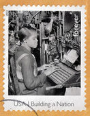 UNITED STATES OF AMERICA - CIRCA 2013: A stamp printed in USA dedicated to building a Nation, shows Lynotipe operator, circa 2013 — Stock Photo