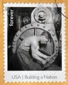 UNITED STATES OF AMERICA - CIRCA 2013: A stamp printed in USA dedicated to building a Nation, shows Powerhouse Mechanic, circa 2013 — Stock Photo