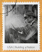 UNITED STATES OF AMERICA - CIRCA 2013: A stamp printed in USA dedicated to building a Nation, shows Welder on Empire State Building, circa 2013 — Stock Photo