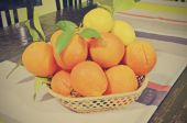Center table with oranges and lemons — Stock Photo