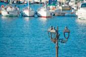 Lamppost by the sea — Stock Photo