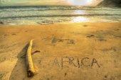 Africa writing at sunset — Stock Photo