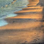 Wavy sand under a bright sun at sunset — 图库照片