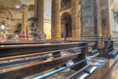 Row of pews in Santa Maria church — Stock Photo