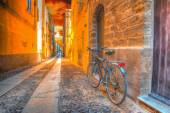 Bicycle in Alghero under a scenic sunset — Stockfoto