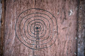 Hand drawn dartboard on a wooden board — Stock Photo