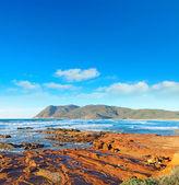 Red rocks by the shore in Porto Ferro — Stock Photo