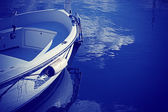 Wooden boat in blue — Stock Photo