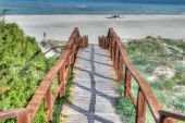 Wooden stairs to the beach — Stock Photo
