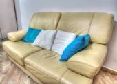 Leather couch with pillows in a living room in hdr — Photo