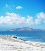 Stintino shoreline under a blue sky with clouds — Stock Photo
