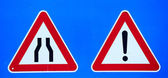 Road signs on blue — Stock Photo