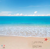 Spring break on the sand under clouds — Stock Photo