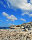 Rocky shore under clouds in Sardinia — Stock Photo