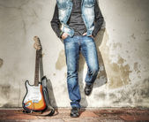 Blue jeans and electric guitar — Стоковое фото
